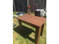 Compact wood effect dining table