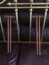 Brass double bed headboard.