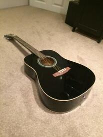 Full size acoustic guitar still new with box