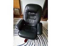 A very comfortable black swivel and (manual) reclining chair in good condition. Collection only.