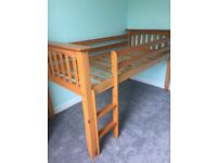 Child's cabin bed with drawers and desk.