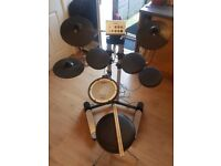 Roland electric drum kit with stool sticks and cables.
