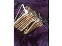 11 wooden coat hangers