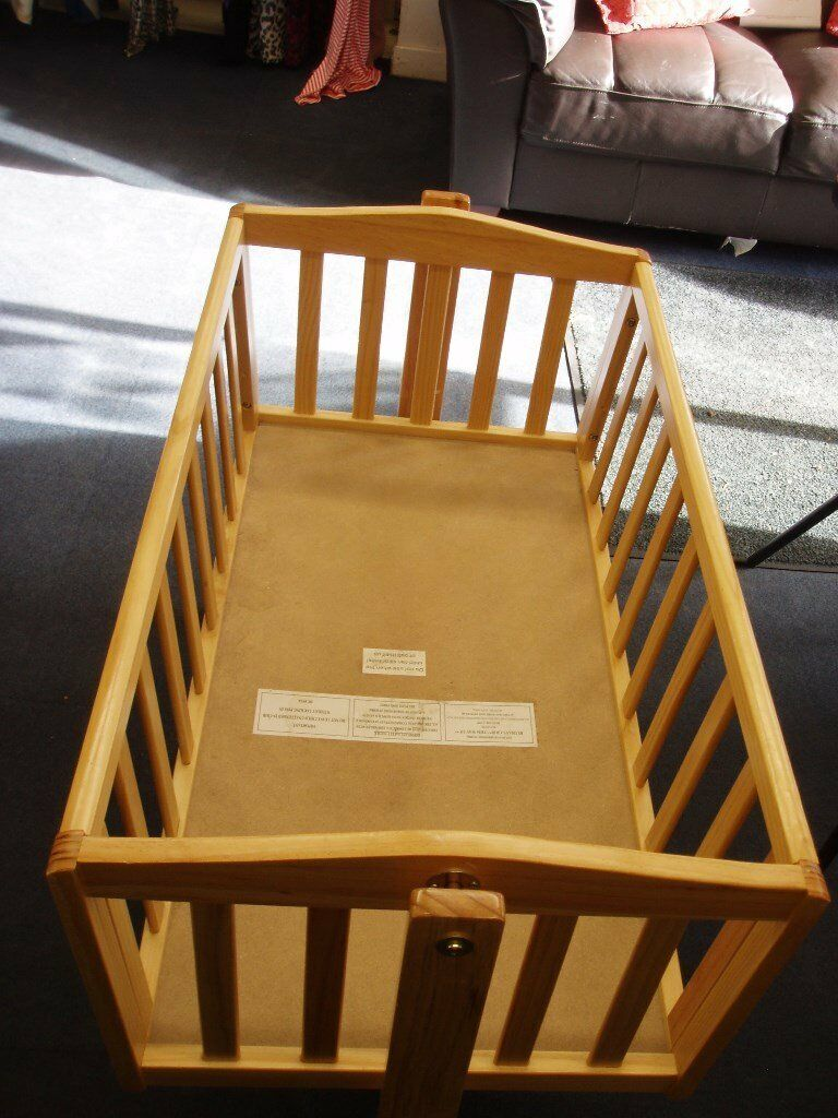 A wooden rocking crib/ cot