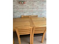 Oak extendable dining table and six chairs