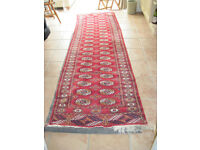 Persian style rug 10' x 3' in good condition.