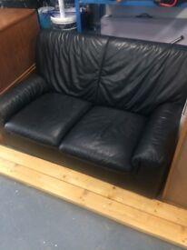 2 seater black leather sofa