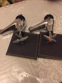 Brand new One pair of cross taps silver
