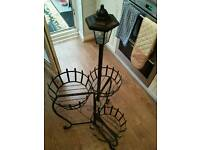 Folding 3 sectioned soler light planter stand in metal..