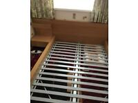 Oak effect double bed frame with bedside unit