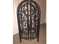 Ornate wrought iron wine rack