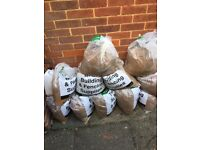 12 BAGS OF BUILDERS SAND. SURPLUS TO REQUIREMENTS.