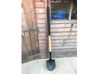 Spade with long straight handle