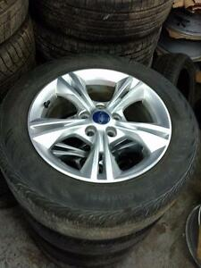 215 55 16 Continental 100% tread allseason tires on OEM 2015 Ford Focus Alloy rims 5 x 108 / TPMS