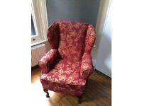 Red, floral armchair