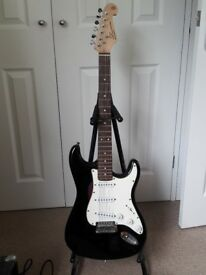 SX Stratocaster style w/ strap and amplifier