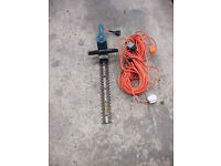 Black & Decker electric hedge trimmer with long cable