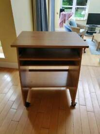 Computer desk with sliding tray