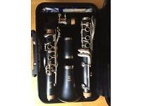 Yamaha Clarinet with 6C mouthpiece, hardly used, excellent condition, comes in strong Yamaha case.