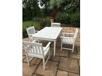 White wooden garden table & 4 chairs.