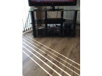 Black smoked glass 3 tier tv stand.