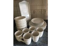 28 sets of heart crockery (plates, mugs, bowls etc)