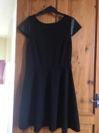 Various dresses for sale.