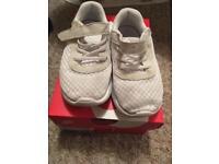 White fabric Nike trainers size 9.5 .