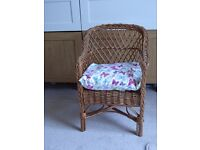 Child's wicker chair with cushion