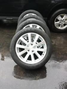 BRAND NEW  TAKE OFF 2017 CHEVY  MALIBU  FACTORY OEM 18 INCH WHEELS WITH  GOODYEAR  HIGH PERFORMANCE 235 / 50 / 18 TIRES