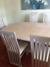 Limed oak dining table & 6 chairs.