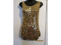 GOLD STRETCHY TOP VEST TYPE SIZE 12 WITH SEQUINS ON THE FRONT