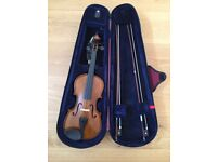 Stentor Half Size Violin with case, shoulder rest and two bows