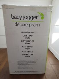 Brand New Baby Jogger Deluxe Carrycot.