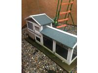 Rabbit hutch with food and bedding