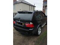 BMW X5 4.6is 90k Black.