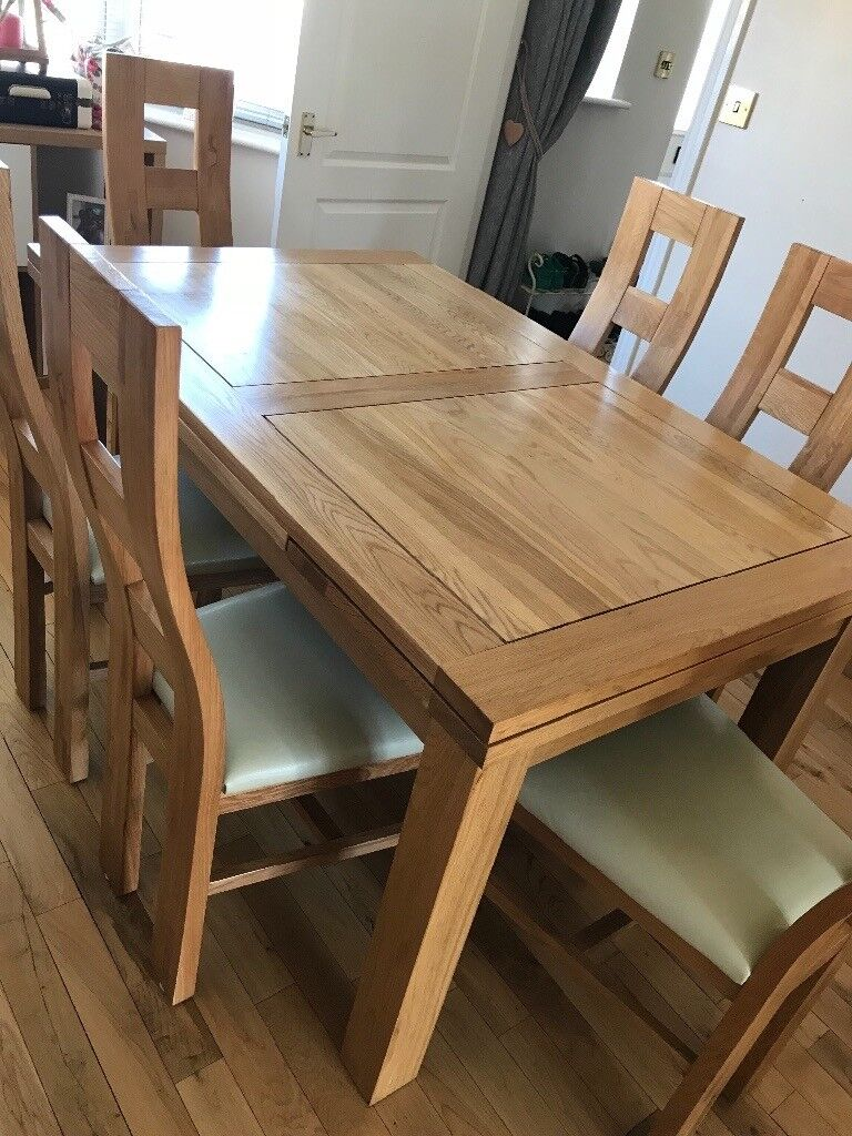 Solid oak extending dining table (6-10 seater) and 6 ...