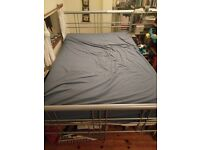 Metal framed double bed and firm mattress - both in good condition. Pick up 9th - 15th April
