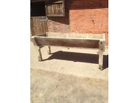 Vintage wood farm animal manger in good condition for age