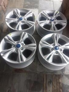 BRAND NEW NEVER MOUNTED FORD  FOCUS  FACTORY OEM  16 INCH ALLOY WHEEL SET OF FOUR.