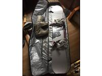 snowboard with boots and bag