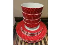 Set of 4 red poka dot bowls and plates