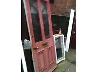 Exterior vintage wooden door with frosted glass