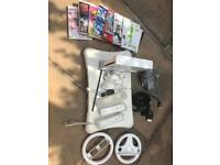Nintendo wii with fitness board and games and controllers