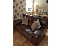Two Brown leather sofas with matching footstall