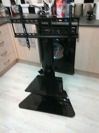 black tv stand with glass shelf