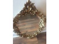 Antique looking, gold affect mirror