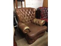 Vintage tan leather monks chair