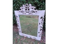 Lovely antique gothic carved mirror with bevelled edge.