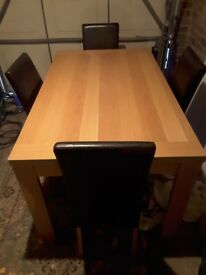 Wood Dining table 4 brown leather chairs